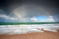 Rainbow over atlantic ocean waves on coast etretat france Royalty Free Stock Photo