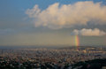 Rainbow over barcelona montjuic hill on city Stock Photos