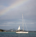 Rainbow over boat in the caribbean Royalty Free Stock Photo