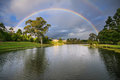 Rainbow over botanical garden Stock Photo