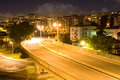 Overpass_Lights_Nightfall Urban Scenery_Rainbow or Hallo Royalty Free Stock Photo