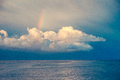 Rainbow over the clouds after storm open sea Royalty Free Stock Photo