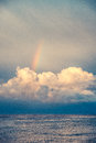 Rainbow over the clouds after storm open sea Royalty Free Stock Photos