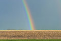 Rainbow over a field in eiderstedt germany Stock Image