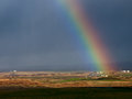 Rainbow over field. Ireland. Royalty Free Stock Photos