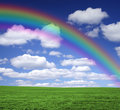 Rainbow over a green field Royalty Free Stock Photo