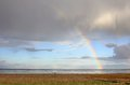 Rainbow over the lower saxon wadden sea at schillig north sea east frisia lower saxony germany Royalty Free Stock Photo
