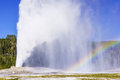 Rainbow over old faithful geyser yellowstone national park wyoming usa Stock Image