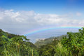 Rainbow over the rain forest at island dominican republic beautiful rainforest Stock Image
