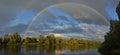 Rainbow over river Royalty Free Stock Photo