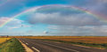 Rainbow Over the Road Stock Image