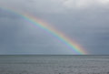 Rainbow over the sea Royalty Free Stock Photo