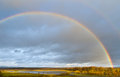 Rainbow over subsiding spring flood of river sukhodrev kaluga region russia Royalty Free Stock Photos
