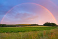 Rainbow over Swedish field Royalty Free Stock Photo