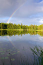 Rainbow over swedish lake landscape with summer Royalty Free Stock Photography