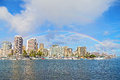 Rainbow over Waikiki beach resort and marina in Honolulu, Hawaii, USA. Royalty Free Stock Photo