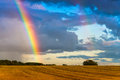 Rainbow over the wheat field landscape Royalty Free Stock Photo