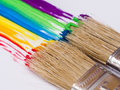Rainbow paint brushes painting colors Stock Images