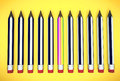 Rainbow pencil stands out from other pencils Royalty Free Stock Photo