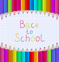 Rainbow of Pencils on Paper Sheet Royalty Free Stock Photo