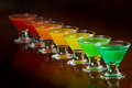 Rainbow shots classic bar flair trick colored juice served in multiple shot glasses in a row Stock Photo
