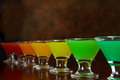 Rainbow shots classic bar flair trick colored juice served in multiple shot glasses in a row Stock Photos