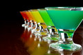 Rainbow shots classic bar flair trick colored juice served in multiple shot glasses in a row Royalty Free Stock Photo