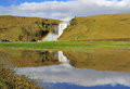Rainbow at skogafoss iceland reflection of scenic waterfall in Stock Photos