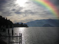 Rainbow in the sky after heavy rain. Lake landscape. Royalty Free Stock Photo