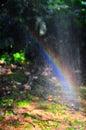 Rainbow through spray of water Royalty Free Stock Photo