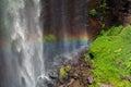 Rainbow on spray from waterfall Royalty Free Stock Photo