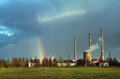 Rainbow spring landscape after the rain over the meadow near the power plant Stock Photos