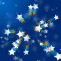 Rainbow stars in blue Stock Photography