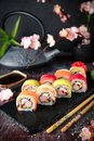 Rainbow Sushi Roll with salmon, eel, tuna, avocado, royal prawn, cream cheese Philadelphia, caviar tobica, chuka. Sushi menu.
