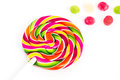 Rainbow sweet sweet bright round lollipop and many colorful little lollipops on a white background Royalty Free Stock Photo