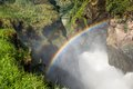 Rainbow At the top of Murchison Falls, the Nile forces its way through a gap in the rocks Royalty Free Stock Photo