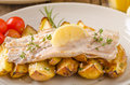 Rainbow trout fillet with roasted potatoes Royalty Free Stock Photo