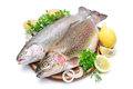 Rainbow trout with fresh herbs isolated on white background Stock Photo