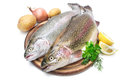 Rainbow trout with fresh herbs isolated on white background Stock Photos