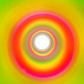 Rainbow tunnel made out of slinky leading to white background colorful a backround Stock Images