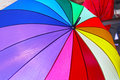 Rainbow umbrella all colors of at open parasol Royalty Free Stock Photo