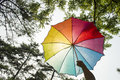 Rainbow umbrella block the sun distraction can effectively Stock Photo