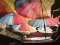 Rainbow umbrellas in penang street photograph Stock Photo