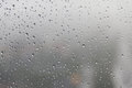Raindrop, water drops on a glass surface of window Royalty Free Stock Photo