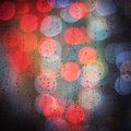 Raindrops and bokeh city lights background Royalty Free Stock Photo