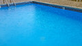 Raindrops on swimming pool Royalty Free Stock Photo