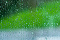 Raindrops in the window abstract and colorful background Stock Photography