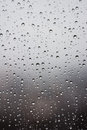Raindrops on the window glass in front of out of focus background Royalty Free Stock Image