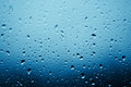 Raindrops on the window glass in front of out of focus background Stock Photography