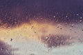 Raindrops on a window pain before a coming storm at sunset Stock Image